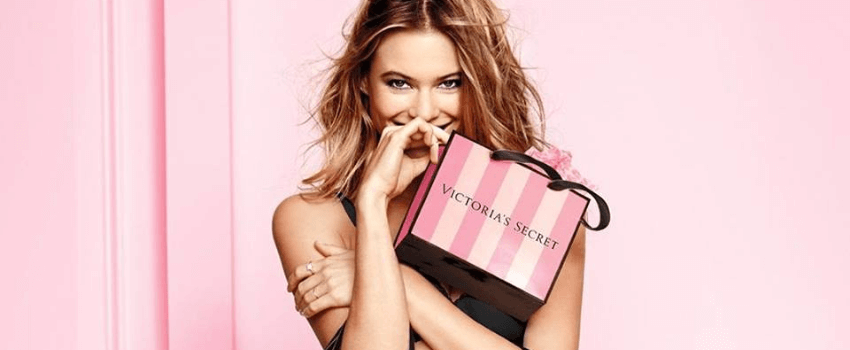 woman holding victoria's secret shopping bags