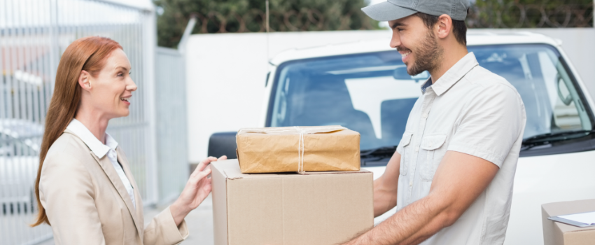 delivery man giving package to woman